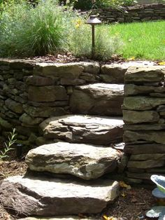 Thick, bulky stone steps give a very rustic look to any home #landscaping