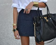 gold accessories, navy, and white blouse...don't care for the handbag with it though