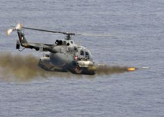 italian air force helicopter firing missiles