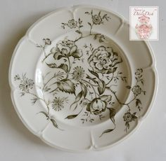 "For consideration is this gorgeous plate from Johnson Brothers depicting an airy mix of botanicals on ironstone. It is a very dark loden green, almost black. Measures: 6"" Condition: Good. No chips or"