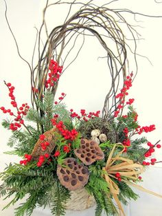 Like a walk in a winter woodland, this is an arrangement that will awaken the senses! Fresh pine, balsam and cedar for fragrance, accented with red berries for color, and a keepsake bird's nest.