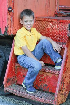 Tween boy on a train pose © Lilac Hill Photography