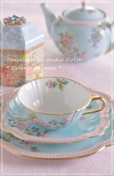 blue and pink teacup and teapot