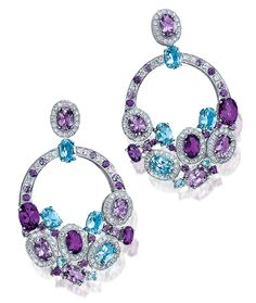 Cellini Aurora Collection Earrings Oval- and pear-shaped amethysts and blue topaz, accented with white diamonds, in 18-karat white gold. Diamond weight: approximately 1.48 carats total; Blue Topaz weight: approximately 3.78 carats total; Amethyst weight: approximately 5.73 carats total.
