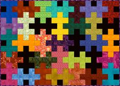 A Jigsaw Puzzle quilt pattern that shows you how to make an easy puzzle quilt. Choose from three differnent block sizes to alter the project's size.