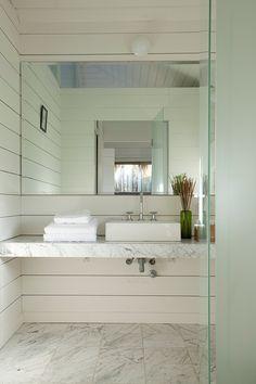 Marble slab counter, shiplap walls // Beach House Martin Gomez Arquitectos