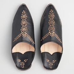Handcrafted by the artisans who make shoes for Moroccan royalty, these authentic babouche shoes are made of 100% goat's leather. With a hand-carved design, traditional sewn-down heel and soft, suede-like leather interior, these slippers will transport you to a cobblestone street in the ancient walled medina of Fes el Bali.