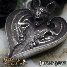 Alchemy Gothic E373 Awaiting The Eventide  A pair of small, antiqued pewter roosting bats, hanging upside down with their wings wrapped around them; on surgical steel ear-wires.