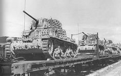 A train load of Italian M.14/40 medium tanks with a lots of extra track sections added for extra protection.
