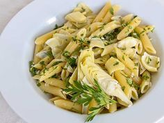 Gremolata Pasta with Artichoke Hearts Gremolata, the traditional Italian blend of chopped parsley, lemon and raw garlic, also makes a quick and pungent pasta topping. With artichoke hearts to mellow out the powerful garlic flavor, it's mega-Mediterranean. Pasta With Artichoke Hearts, Artichoke Heart Recipes, Artichoke Pasta, Cheap Pasta Recipes, Yummy Pasta Recipes, New Recipes, Healthy Recipes, Favorite Recipes, Amazing Recipes
