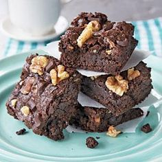 These fudge-walnut brownies are so decadent tasting, you won't believe that they're lower in fat than traditional brownies. To ensure a nice fudgy texture, take care not to overbake. Large chocolate chunks create big, luxurious pockets of melty chocolate in the brownies, but you can always substitute chocolate chips.