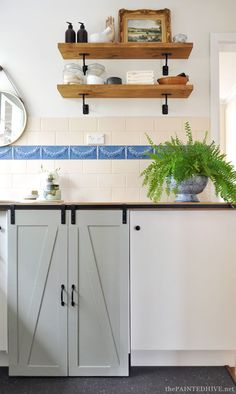 DIY Budget Laundry Makeover with sliding barn doors