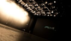 Image of lighting rig projecting into a dark space inside the Black Box Theater