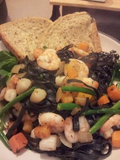 Squid ink pasta with scallops and prawns