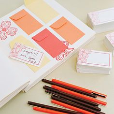 For the guest book, Rebecca pasted mini envelopes from Paper Source into a Kolo photo album embellished with dogwood ink-stamps. Guests wrote messages to the couple on tiny cards, and then placed them in the envelopes.