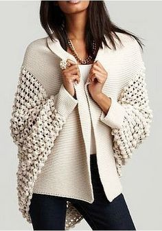 Incredibly stylish and incredibly wearable!! Would love to crochet this... yarn selection critical and work a suitable pattern for the sleeves.