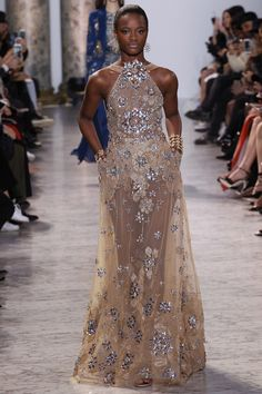 Red carpet fave Elie Saab showed his latest couture line in Paris Wednesday and I guarantee you will see these looks on every red carpet for the next year (I will be surprised if none of these are at the Oscars, too).