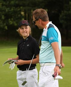 Ian Poulter giving some advice to a junior before he takes his shot on the golf course