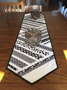 Black and white table runner. It displays very nicely. I handsewed the binding on the back of it. It is made of all cottons. It measures 60 long by 15 wide. Would look nice on a long or shorter table Quilted Table Runners Christmas, Patchwork Table Runner, Table Runner And Placemats, Table Runner Pattern, Quilt Table Runners, Modern Table Runners, Quilt Modernen, Black And White Quilts, Quilted Table Toppers