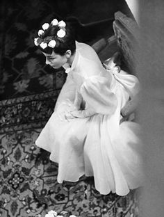 Audrey Hepburn on her wedding day in Bürgenstock, Switzerland, September 25,1954. Audrey was wearing a tea length wedding dress designed by French fashion designer Pierre Balmain and a floral crown.
