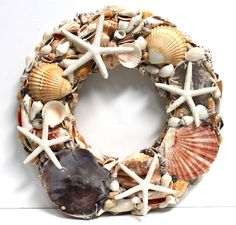 "14"" Decorative wreath made from rattan and assorted starfish and seashells #seashellwreath, #shellcrafts, #beachdecor, #californiaseashellcompany"