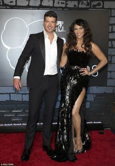 Happier times: Patton, seen here in 2013 with her ex-husband of nine years, Robin Thicke e...