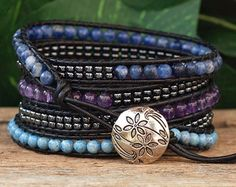 This four wrap bracelet features 5x5mm Miyuki Tila Beads, in gorgeous shades of blue and silver, meticulously ladder-stitched on to top quality Blue