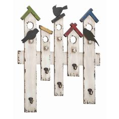 Featuring a charming design inspired by classic birdhouses, this inviting wall hook features a wooden build with a colorful finish and silhouettes of chirping birds, this charming piece is complete with five hooks to hang keys, hats, leashes and more.