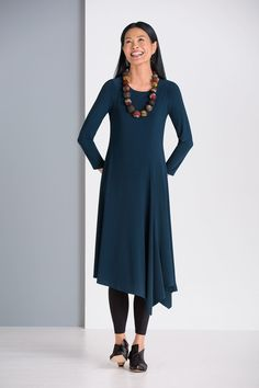 Eve Dress by Comfy USA. With its elegant and flattering lines, this asymmetrical matte jersey dress can take you anywhere, casual to dressy. Off-center seams front and back add shape and interest.