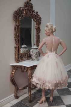 Mooshki Evie - Layers upon layers of champagne tulle create a tier effect skirt…
