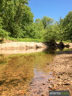 South Fork Peachtree Creek meanders through Herbert Taylor Park, its sandy shores popular as a dog swimming hole