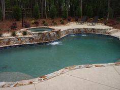 Charlotte Pool Pictures, free form pool design, raised spa with sheer descents and tanning shelf