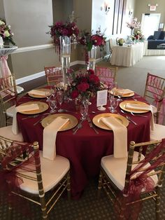 This gorgeous table set up is filled with upgrades! Floor length Burgundy table cloth, champagne napkins, gold charger plates, gold chiavari chairs and burgundy chair sashes