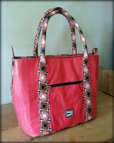 ec3eabd21d Azonto Bag made from used advertising billboard and beautifully lined with  African print fabric.