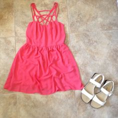 Caged Dress from Forever21 Cute coral colored dress with caged detailing in the front and back. The dress comes in at the waist and flows down, making it very flattering. Forever 21 Dresses Mini