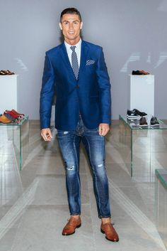 Cristiano Ronaldo wearing CR7 Tango Metal Blake Oxford, CR7 Slim Fit Shirt, Sacoor Brothers Notch Lapel Blazer, Dsquared2 Sexy Crop Boot Cut Jeans