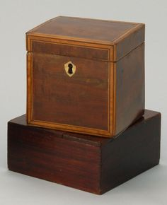 """Antique Federal Tea Caddy Circa 1820 in mahogany with boxwood & ebony inlay.  Ivory escutcheon. 4.75""""H, 4.5""""W, 4""""D from Eldred's Auctioneers"""