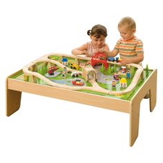 Train Table Set.    Complete 59-piece train set with table! Imaginative details and bright colors make this train set a joy.  Made of durable wood with child-friendly paint and lacquer.  Table is perfectly sized for your toddler and designed for children 3 years and older. -- Julianna