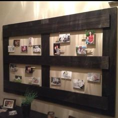 photo display using wire an pins on unique wood frame
