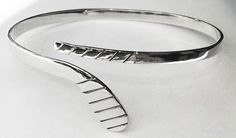 """Ice Hockey Stick Wrap Bracelet in Sterling Silver. It is adjustable and fits wrists from 5.5""""-7"""" circumference comfortably"""