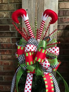 Christmas Tree Bow Topper - Red Polka Dot, Lime Green, & Black Houndstooth Ribbon w/ Assorted Picks / Elf Feet by ThoseBowsThough on Etsy https://www.etsy.com/listing/539885746/christmas-tree-bow-topper-red-polka-dot