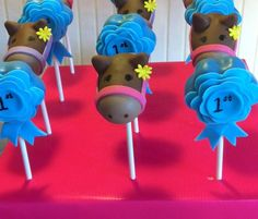 Love these pony and rosette themed cake pops  Looks like a good idea for Easter!