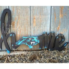 Handmade Carolina Panthers wood sign. Drawn, cut and painted by hand. #carolinapanthers #keeppounding #redfeatherdesigns