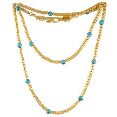 "Gold Tone and Turquoise Bead Sautoir by Chanel. A stunning gold tone ""Baht"" chain necklace with turquoise and Gold plated beads by Chanel. This necklace features a stylized clasp with two inner locking ""C's"". 1990s"