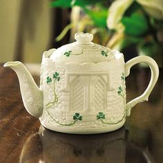 """Belleek Irish Pottery Castle Teapot (5151)  An Irish Handcrafted Belleek Castle Teapot is a great gift for your home or even to add to your collection.    This Irish Pottery is sculpted into a Castle with striking detail and handpainted green shamrocks.  This Castle Teapot from Ireland measures at 4.5""""   Belleek Pottery   When you buy a piece of Belleek China you become the owner of a truly unique piece of Irish craftsmanship. -- $114.99"""