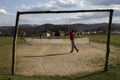 SERVE: Youths played tennis on an improvised court in the village of Turija, near Lukavac, Bosnia and Herzegovina, Sunday. (Amel Emric/Associated Press)