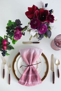 Offset dark floral arrangements with ombré napkins and crystal goblets in a lighter shade of marsala. #PlaceSetting #WeddingDecor Photography: Gary Ashley / Gather Events. Read More: http://www.insideweddings.com/news/planning-design/marsala-wedding-ideas-inspired-by-pantones-color-of-the-year/2023/