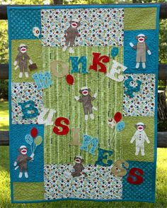 Just monkeying around! This quilt is appliqued with machine embroidery sock monkey appliques and applique lettering.