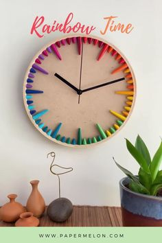 This darling rainbow clock is a perfect combination of modern and quirky. Use in a neutral interior for a touch of color, or match to one of your accents. The clock dial has a colorful gradation of rainbow paper beads as hour and minute indicators. The beads are handcrafted from exquisite eco-friendly paper. Rainbow Magic, Rainbow Paper, Rainbow Wall, Contemporary Clocks, Eco Friendly Paper, Paper Beads, House Colors, Wall Art Decor, House Warming