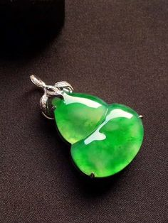 Beautiful vivid full green carved Burmese jadeite jade pendant with 925 sterling silver cubic zirconia bail Type A